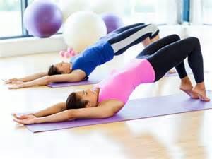 Clases de pilates postural y bienestar.