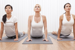 Three girls taking a pilates class