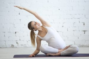 Pregnant young women doing pilates